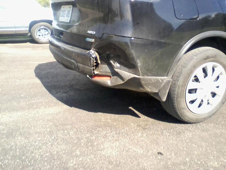 Crumpled bumper before shot
